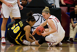 March 22, 2010; Stanford, CA, USA;  Stanford Cardinal guard JJ Hones (10) and Iowa Hawkeyes forward Gabby Machado (50) fight for a loose ball during the first half in the second round of the 2010 NCAA womens basketball tournament at Maples Pavilion. Stanford defeated Iowa 96-67.