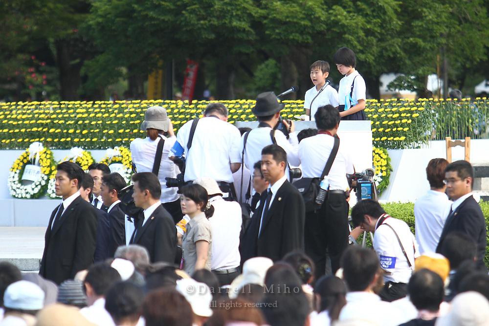 Aug. 06, 2010 ; Hiroshima, JPN - Mikina Takamatsu (R), a sixth grader at Fukuromachi Elementary School in Hiroshima, stood on a two-foot riser along with sixth grader Kazuhiro Yokobayashi from Furutudai Elementary School at the 2010 Hiroshima Peace Memorial Ceremony in Peace Park.