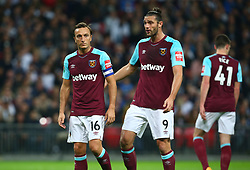 October 25, 2017 - London, England, United Kingdom - L-R West Ham United's Mark Noble and West Ham United's Andy Carroll.during Carabao Cup 4th Round match between Tottenham Hotspur and West Ham United at Wembley Stadium, London,  England on 25 Oct  2017. (Credit Image: © Kieran Galvin/NurPhoto via ZUMA Press)