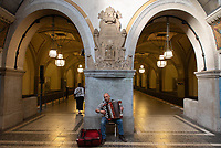 An accordion player in Heidelbergerplatz station, Berlin.