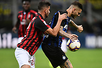 Davide Calabria of AC Milan and Mauro Icardi of Internazionale compete for the ball during the Serie A 2018/2019 football match between Fc Internazionale and AC Milan at Giuseppe Meazza stadium Allianz Stadium, Milano, October, 21, 2018 <br />  Foto Andrea Staccioli / Insidefoto