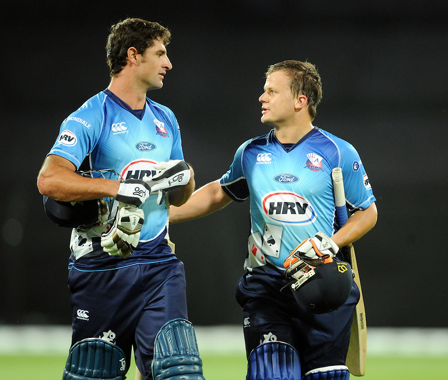 Auckland Aces Colin De Granholme, left and Auckland Aces Craig Cachopa after hitting the winning runs against Wellington Firebirds in the HRV T20 cricket match at Westpac Stadium, Wellington, New Zealand, Saturday, November 23, 2013. Credit:SNPA / Ross Setford