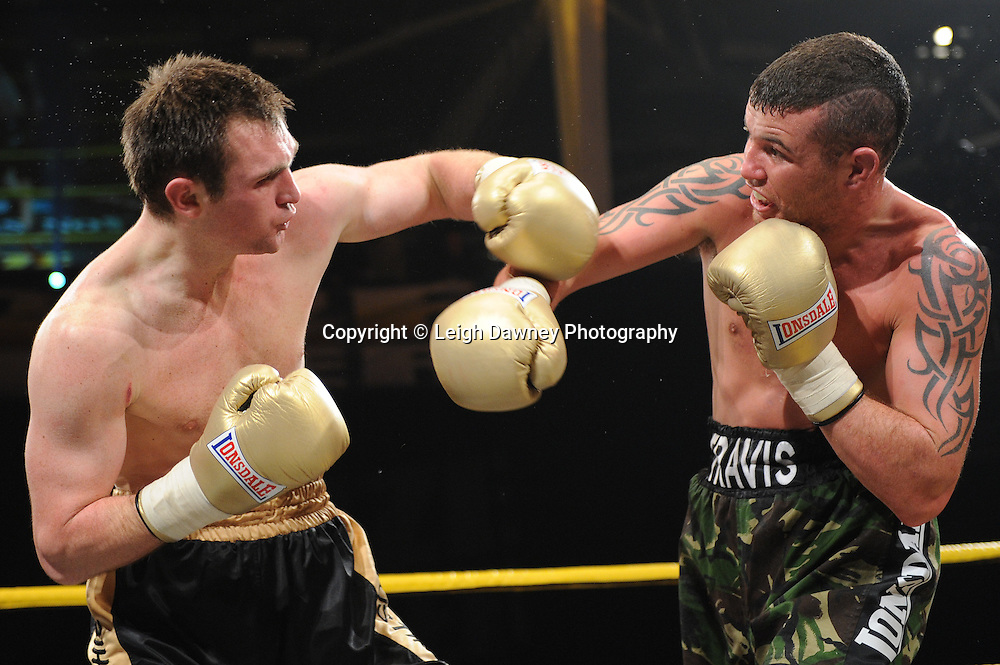 Travis Dickinson defeats Justin Jones (black shorts) at Prizefighter The Light Heavyweights II, Olympia, London on 29th January 2011. Photo credit © Leigh Dawney.