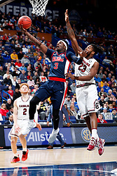ST. LOUIS, Mo., -- Game 02 of the 2018 SEC Men's Basketball Tournament played between Ole Miss and South Carolina, Wednesday, March 07, 2018 at the Scott Trade Center in ST. LOUIS. Ole Miss guard Terence Davis, left, drives on South Carolina guard Evan Hinson in the second half.