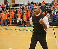 Springville head coach Claude Howard is pumped up after their win in the Class 1A regional final match at Iowa City West High School in Iowa City on Wednesday, November 6, 2013. Springville defeated New London 3-2.