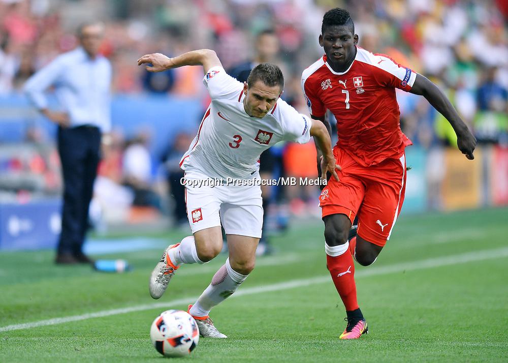 2016.06.25 Saint-Etienne<br /> Pilka nozna Euro 2016<br /> mecz 1/8 finalu Szwajcaria - Polska<br /> N/z Artur Jedrzejczyk Breel Embolo<br /> Foto Lukasz Laskowski / PressFocus<br /> <br /> 2016.06.25<br /> Football UEFA Euro 2016 <br /> Round of 16 game between Switzerland and Poland<br /> Artur Jedrzejczyk Breel Embolo<br /> Credit: Lukasz Laskowski / PressFocus