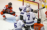 2012/03/13 - RIT's Matt Garbowsky watches the game-winning goal cross the goal line less than 3:00 into overtime in the Atlantic Hockey Semifinal against Niagara University at the Blue Cross Arena on March 16th, 2012. RIT won 2-1.