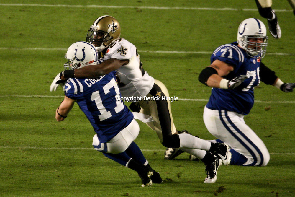 2010 February 07: New Orleans Saints cornerback Malcolm Jenkins (27) hits Indianapolis Colts wide receiver Austin Collie (17) during a 31-17 win by the New Orleans Saints over the Indianapolis Colts in Super Bowl XLIV at Sun Life Stadium in Miami, Florida.
