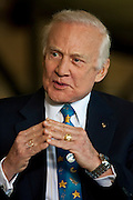 """Apollo 11 astronaut Buzz Aldrin discusses space exploration in the Saturn V building at Johnson Space Center April 15, 2008 in Houston, Texas. """"Buzz"""" Edwin Eugene Aldrin, Jr. was the second man on the moon during the historic Apollo 11 mission July 20, 1969. (Photo by Dave Einsel)"""