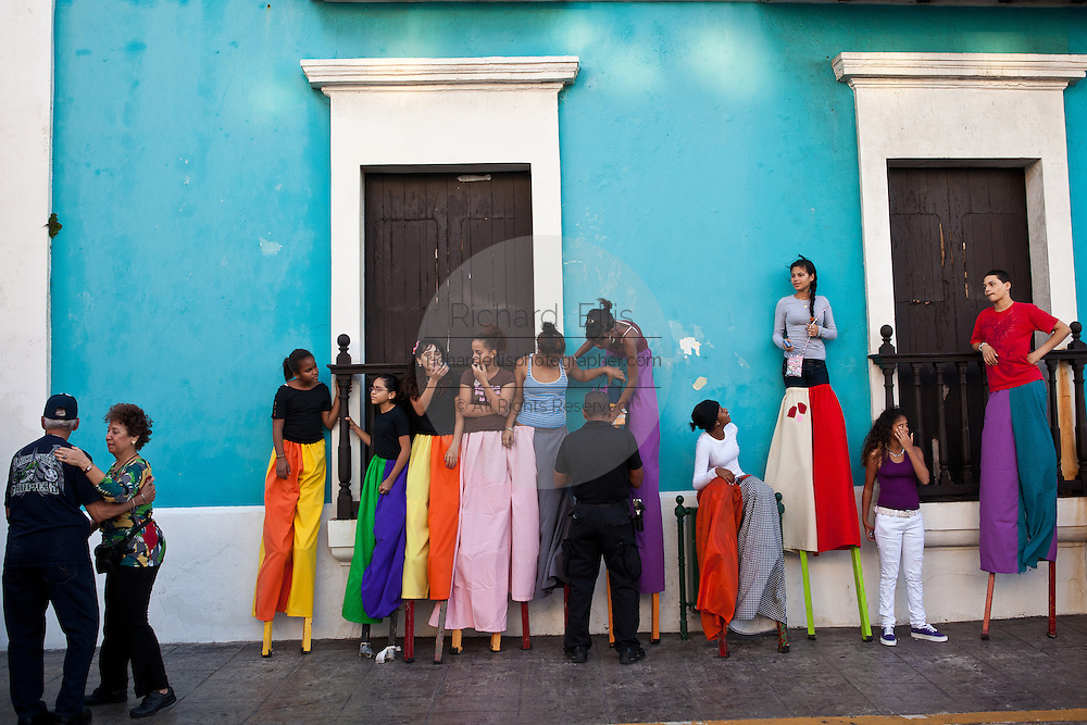 Stilt walkers prepares to parade in the Festival of San Sebastian in San Juan, Puerto Rico.