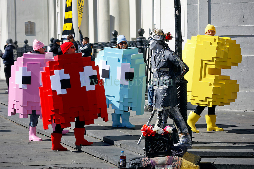 09 February 2016. New Orleans, Louisiana.<br /> Mardi Gras Day. A group dressed as Pacmen. One of the many bright and colourful costumes in the French Quarter. <br /> Photo©; Charlie Varley/varleypix.com