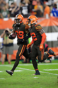 Cleveland Browns defensive back Terrance Mitchell (39) celebrates with Cleveland Browns defensive back Jabrill Peppers (22) after intercepting a late fourth quarter pass that clinches the Browns first win since 2016 during the 2018 NFL regular season week 3 football game against the New York Jets on Thursday, Sept. 20, 2018 in Cleveland. The Browns won the game 21-17. (©Paul Anthony Spinelli)
