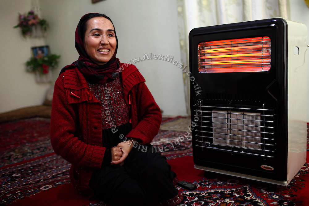 Aghele Rezaie, 30, (right) the famous Afghan actress who has taken part in the controversial movie 'At Five in the Afternoon' (Winner of the Cannes Film Festival Jury Prize in 2003) is portrayed while sitting in her home in Kabul, Afghanistan. 'At Five in the Afternoon' focuses on the life of a progressive young woman who dreams of growing up to become the President of the Republic despite her oppressive home life and a strained relationship with her bigoted but loving father. The film follows the daily struggles of Afghan women in post-Taliban Afghanistan with tenderness and hope against a tragic background of death and despair. .