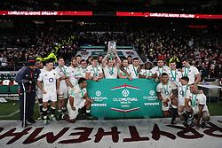 England players celebrate with the Autumn International trophy during the Autumn International match at Twickenham Stadium, London.