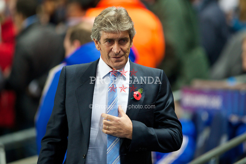 MANCHESTER, ENGLAND - Tuesday, November 5, 2013: Manchester City's manager Manuel Pellegrini before the UEFA Champions League Group D match against CSKA Moscow at the City of Manchester Stadium. (Pic by David Rawcliffe/Propaganda)