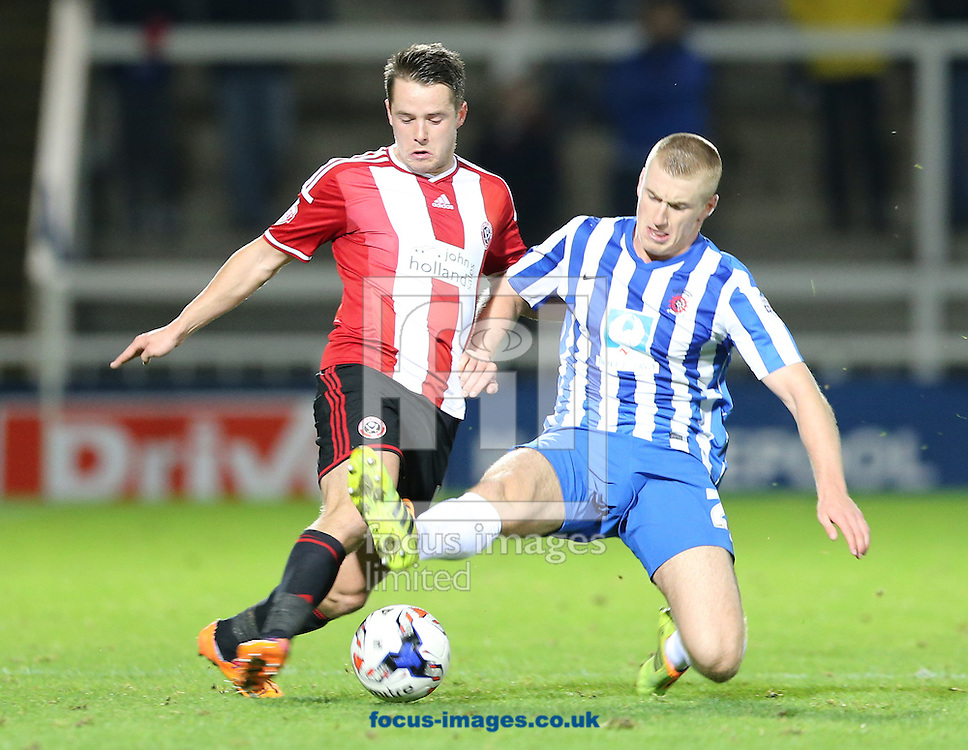 Scott Harrison (r) of Hartlepool United and Marc McNulty of Sheffield United during the Johnstone's Paint Trophy match at Victoria Park, Hartlepool<br /> Picture by Simon Moore/Focus Images Ltd 07807 671782<br /> 07/10/2014