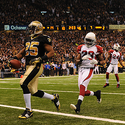 16 January 2010:  New Orleans Saints running back Reggie Bush (25) runs past Arizona Cardinals cornerback Greg Toler (28) for a touchdown run during a 45-14 win by the New Orleans Saints over the Arizona Cardinals in a 2010 NFC Divisional Playoff game at the Louisiana Superdome in New Orleans, Louisiana.