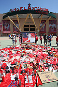 ANAHEIM, CA - APRIL 26:  Fans gather to view a memorial in honor of pitcher Nick Adenhart #34 of the Los Angeles Angels of Anaheim (who was killed in a traffic accident on April 9) prior to the game against the Seattle Mariners at Angel Stadium on Sunday, April 26, 2009 in Anaheim, California.  The Angels shut out the Mariners 8-0.  (Photo by Paul Spinelli/MLB Photos via Getty Images) *** Local Caption *** Nick Adenhart