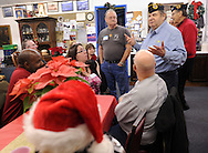 LEVITTOWN, PA -  DECEMBER 15:  Angelo DePalma (R) welcomes former homeless veterans and family members to a holiday dinner hosted by the Jewish War Veterans of America - Bristol and partnered with the Levittown Disabled American Veterans - Post 117 December 15, 2013 in Levittown, Pennsylvania. (Photo by William Thomas Cain/Cain Images)