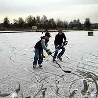 As temperatures dropped to -7, brothers Blair and Callum MacGregor get in some ice hocey practise on the forzen boating lake on Perth's South Inch.<br />Picture by Graeme Hart.<br />Copyright Perthshire Picture Agency<br />Tel: 01738 623350  Mobile: 07990 594431
