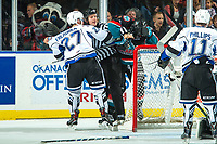 KELOWNA, CANADA - OCTOBER 4: Linesman Dustin Minty gets between Jared Freadrich #27 of the Victoria Royals and a Kelowna Rockets' player on October 4, 2017 at Prospera Place in Kelowna, British Columbia, Canada.  (Photo by Marissa Baecker/Shoot the Breeze)  *** Local Caption ***