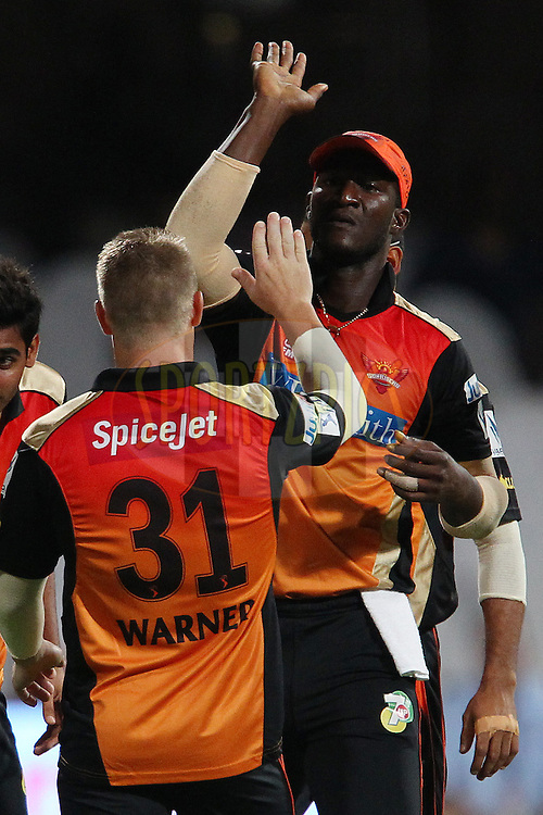 Darren Sammy of the Sunrisers Hyderabad celebrates the wicket of Chris Gayle of the Royal Challengers Bangalore during match 24 of the Pepsi Indian Premier League Season 2014 between the Royal Challengers Bangalore and the Sunrisers Hyderabad held at the M. Chinnaswamy Stadium, Bangalore, India on the 4th May  2014<br /> <br /> Photo by Ron Gaunt / IPL / SPORTZPICS<br /> <br /> <br /> <br /> Image use subject to terms and conditions which can be found here:  http://sportzpics.photoshelter.com/gallery/Pepsi-IPL-Image-terms-and-conditions/G00004VW1IVJ.gB0/C0000TScjhBM6ikg