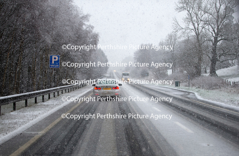 Cars travel northbound the A9 north of Bruar and Calvine  as the first serious snowfall of the winter hits Perthshire...07.12.14<br /> Picture by Graeme Hart.<br /> Copyright Perthshire Picture Agency<br /> Tel: 01738 623350  Mobile: 07990 594431