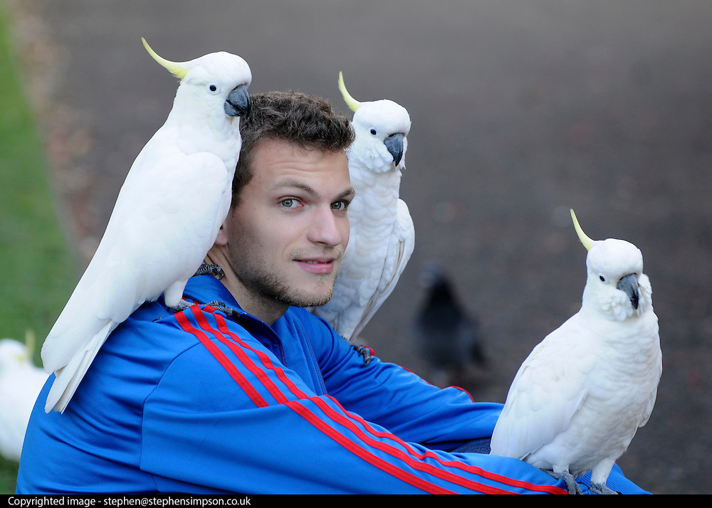AUSTRALIA - SYDNEY  A young man sits with three white cockatoos on him at The Royal Botanical Garden's Sydney  04/01/2010. STEPHEN SIMPSON...
