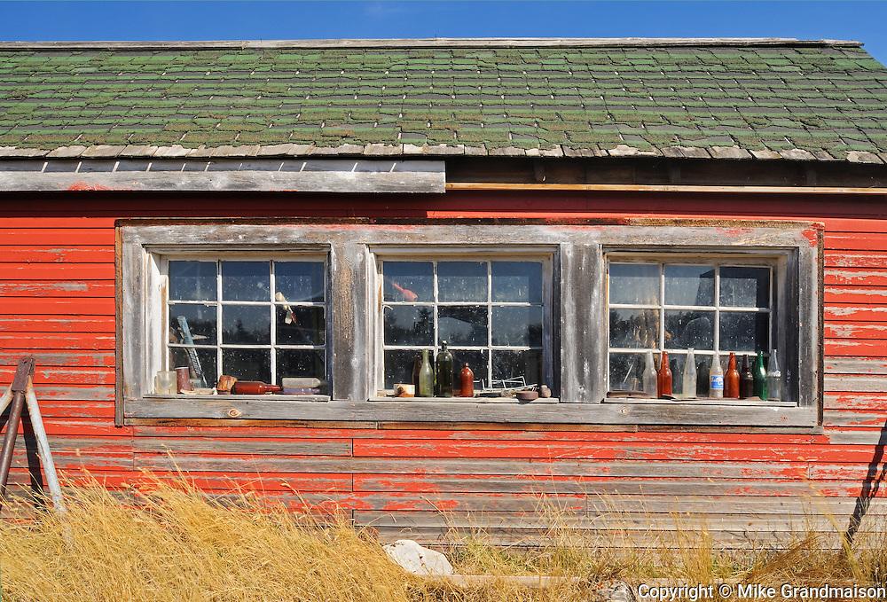Bottles along window sill<br /> Laverna<br /> Saskatchewan<br /> Canada