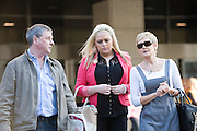 Andrew and Angela Furlong and their daughter Andrea  leave the Tokyo District Court following the third day of proceedings in the case of Richard Hinds, who is accused of murdering Nicola last May, in Tokyo, Japan on 05 March 2013. Photographer: Robert Gilhooly