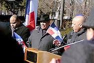El rep. St. Marco Devel- izg con sombrero- escucha las palabras de William Lantigua, alcadel de Lawrence, durante el acto  de conmmemoración del Bicentario de Juan Plablo Duarte, padre de la patria dominicana. En el acto se izo la bandera dominicana frente al City Hall- (ayuntamiento0