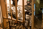 "05 FEBRUARY 2005 - NOGALES, SONORA, MEXICO: Nogales, Mexico, stand in the doorway of the city jail. Members of ""Grupo Operativos"" a special operations unit of the Nogales, Sonora, Mexico, police department, on patrol in Nogales, Saturday night, Feb. 5. The Operativos specialize in anti-gang enforcement and drug interdiction missions. In recent months they have stepped up patrol activity in Nogales communities near the border. In January 2005, the US Department of State has issued a travel advisory advising US citizens to avoid travel along the US Mexican border because of increased violence, including the kidnapping of US citizens, in border communities. Most of the violence has been linked to the drug cartels, who are increasingly powerful in Mexico. The Operativos also patrol the districts of Nogales frequented by US tourists in an effort to prevent crime directed against US citizens.   PHOTO BY JACK KURTZ"