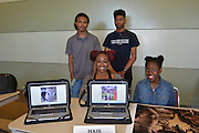 Houston Academy for International Studies students display posters created with PhotoShop at HISD's second annual Digital Learning Expo at Hattie Mae White Educational Support Center