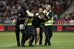 stewards with pitch intruder, during the UEFA Champions League third round qualifying first leg match between OGC Nice and Ajax Amsterdam on July 26, 2017 at the Allianz Riviera in Nice, France