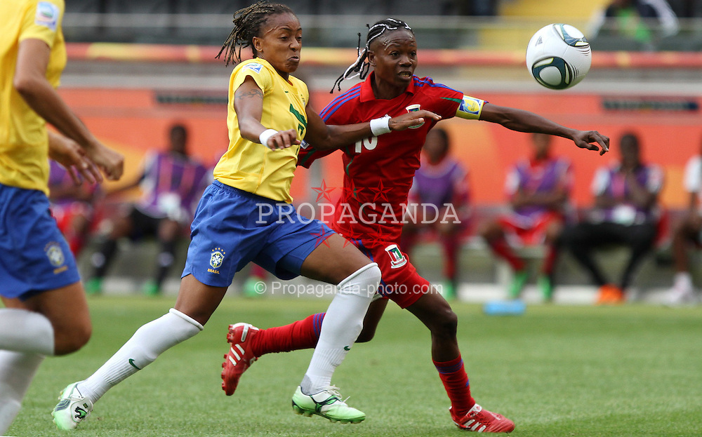 06.07.2011, Commerzbank-Arena, Frankfurt, GER, FIFA Women Worldcup 2011, Gruppe D, Äquatorial-Guinea (EQG) vs. Brasilien (BRA) ,. im Bild Anonman (EQG) gegen Ester (BRA) . // during the FIFA Women´s Worldcup 2011, Pool D, Equatorial Guinea vs Brazil on 2011/07/06, Commerzbank-Arena, Frankfurt, Germany. EXPA Pictures © 2011, PhotoCredit: EXPA/ nph/  Karina Hessland       ****** out of GER / CRO  / BEL ******