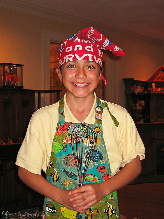 A smiling young cook, Ashlyn age 10, dressed in her newest chef attire ready to perpare dinner