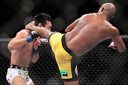 August 27, 2011; Rio De Janiero, Brazil; Anderson Silva (black/yellow trunks) and Yushin Okami (white trunks) during their UFC Middleweight Championship bout at UFC 134 in Rio De Janiero.