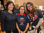 Houston ISD Trustee Anne Sung, left, and Pilgrim Principal Diana Castillo, right, pose for a photograph with Ariel DeLeon, center, after she won two tickets to Super Bowl LI during the Houston launch of the Character Playbook, a joint initiative of the NFL and the United Way Worldwide at Pilgrim Academy, February 3, 2017.