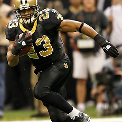 December 4, 2011; New Orleans, LA, USA; New Orleans Saints running back Pierre Thomas (23) against the Detroit Lions during a game at the Mercedes-Benz Superdome. The Saints defeated the Lions 31-17. Mandatory Credit: Derick E. Hingle-US PRESSWIRE