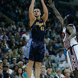 28 January 2009: Denver Nuggets forward Linas Kleiza (43) shoots over Julian Wright (32) during a 94-81 win by the New Orleans Hornets over the Denver Nuggets at the New Orleans Arena in New Orleans, LA. The Hornets wore special throwback uniforms of the former ABA franchise the New Orleans Buccaneers for the game as they honored the Bucs franchise as a part of the NBA's Hardwood Classics series. .