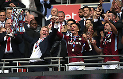 Aston Villa manager Dean Smith (left) and Jack Grealish celebrate lifting the Sky Bet Championship Play-off Final Trophy after the final whistle