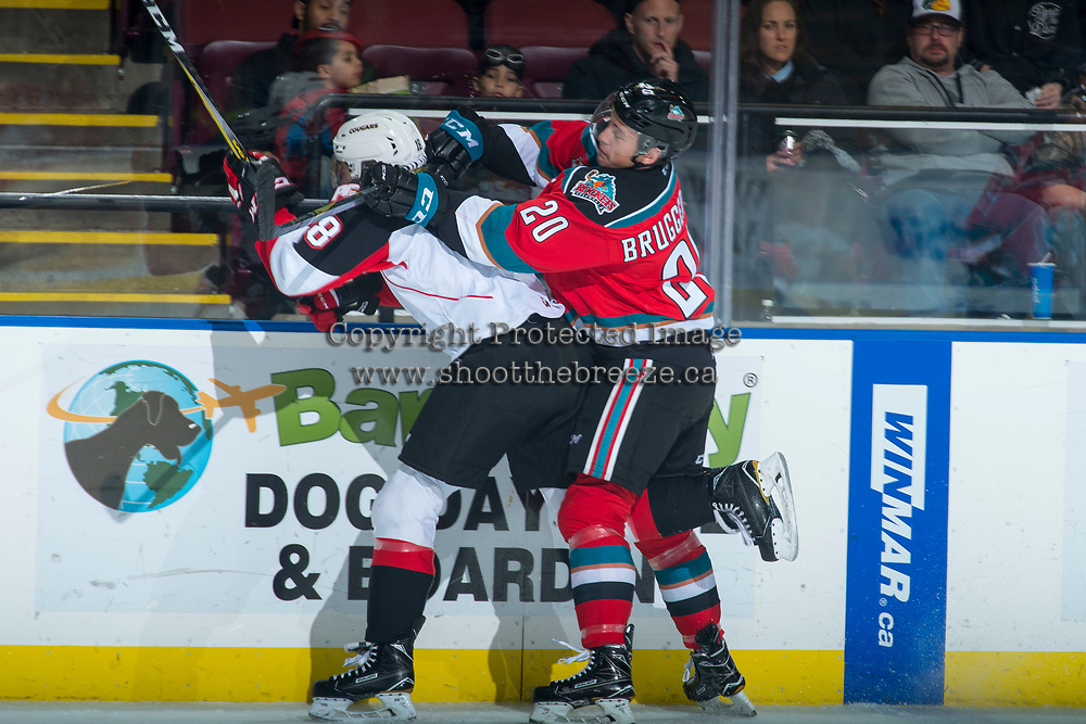 KELOWNA, CANADA - OCTOBER 28: Conner Bruggen-Cate #20 of the Kelowna Rockets checks Jack Sander #18 of the Prince George Cougars in to the boards during first period on October 28, 2017 at Prospera Place in Kelowna, British Columbia, Canada.  (Photo by Marissa Baecker/Shoot the Breeze)  *** Local Caption ***