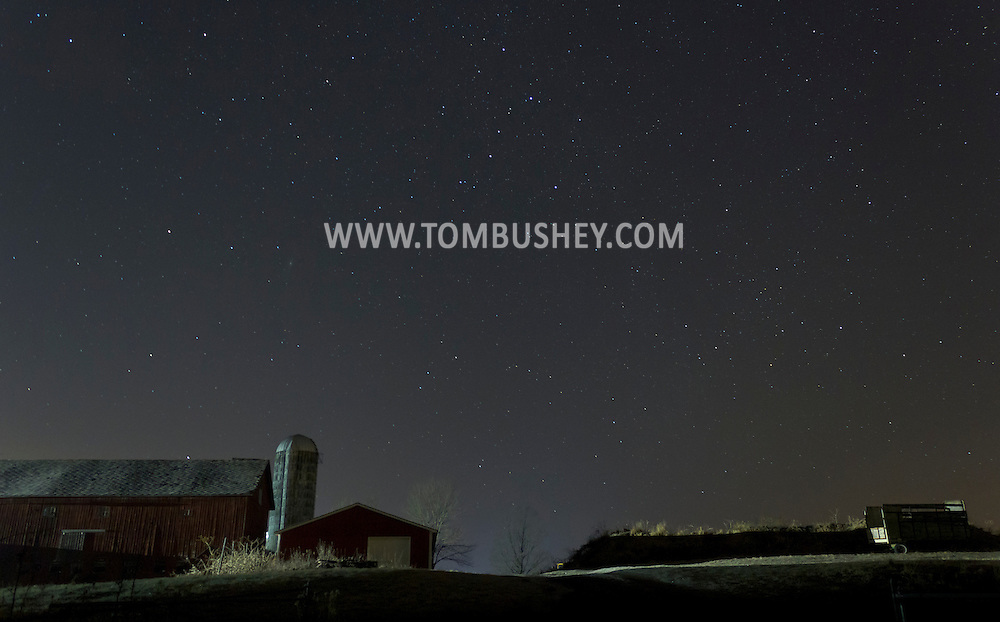 Campbell Hall, New York - Stars shine in the night sky above a farm on Dec. 14, 2012.