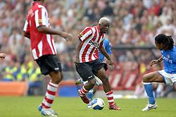 17-09-2006 VOETBAL: PSV - FEYENOORD: EINDHOVEN <br /> PSV verslaat in eigen huis Feyenoord met 2-1 / Arouna Kone<br /> &copy;2006-WWW.FOTOHOOGENDOORN.NL