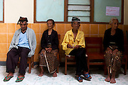 11/4/2010 Kemalang, Indonesia: group of elderly people sit on their camp actually their camp is a school. School are more safe and dry