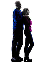one caucasian couple senior standing looking away  silhouette  in silhouette studio isolated on white background