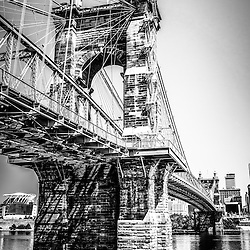 Roebling Bridge Cincinnati black and white picture. The John A. Roebling Suspension Bridge was built in 1865 and crosses the Ohio River connecting Covington Kentucky with Cincinnati Ohio. Photo Copyright © 2012 Paul Velgos with All Rights Reserved.