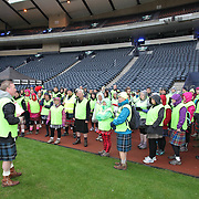Images from The Glasgow Kiltwalk 2013. The volunteers are given their safety talk.