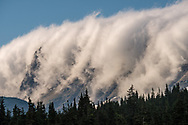 Orthographic clouds pouring over Pollack Mountain in Glacier National Park, Montana