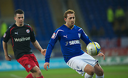 CARDIFF, WALES - Tuesday, February 1, 2011: Cardiff City's Michael Chopra and Reading's Ian Harte in action during the Football League Championship match at the Cardiff City Stadium. (Photo by Gareth Davies/Propaganda)
